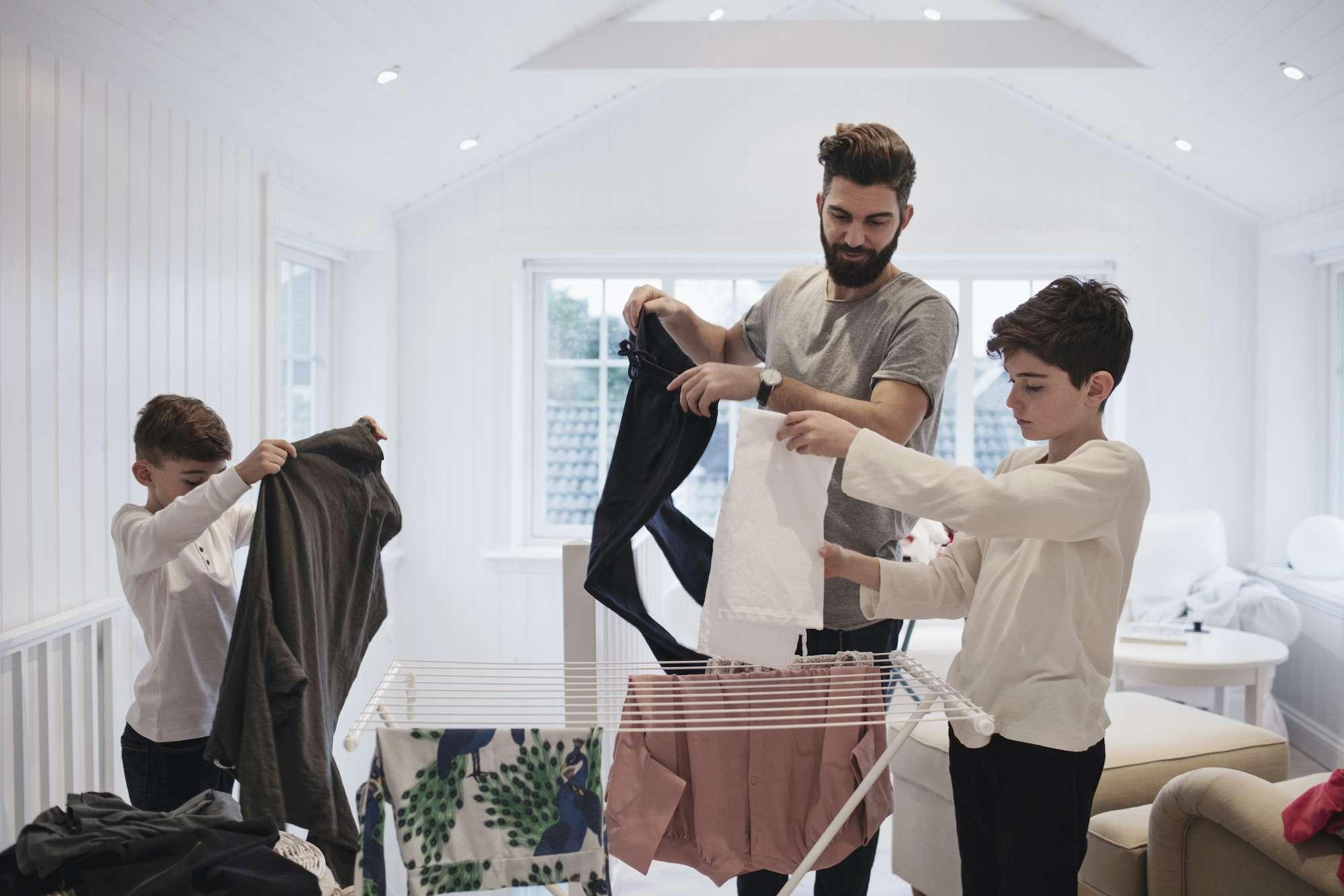 kids folding laundry
