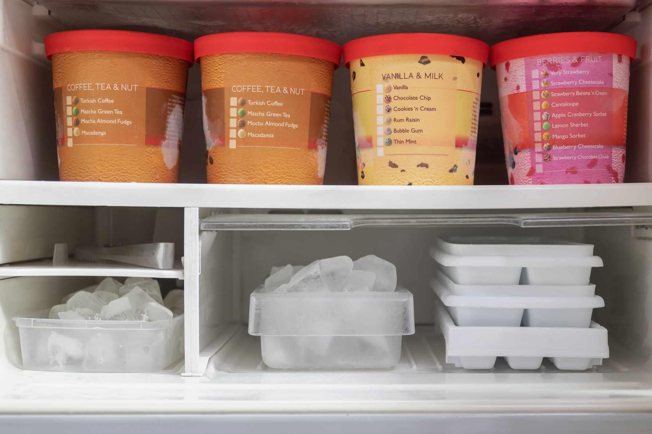 Ice cream pints in the freezer.