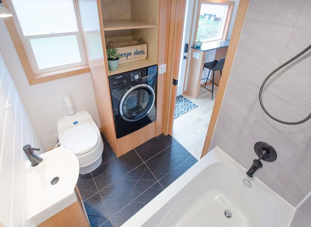 Overhead view of bathroom with toilet and laundry closet