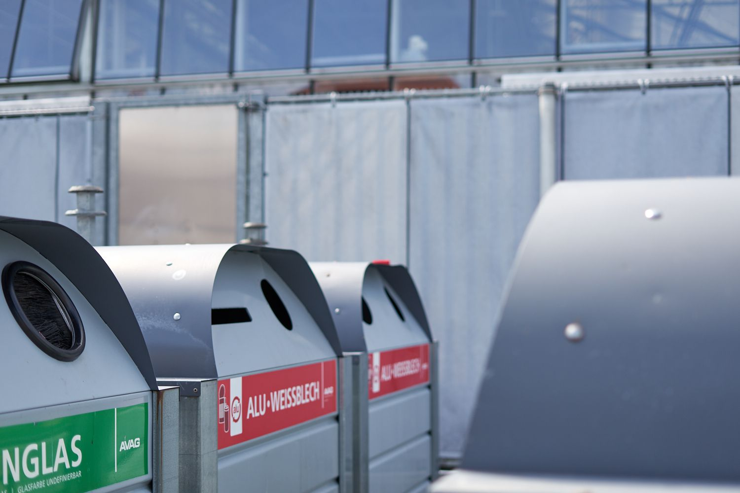 commercial metal recycling bins with labels in Polish