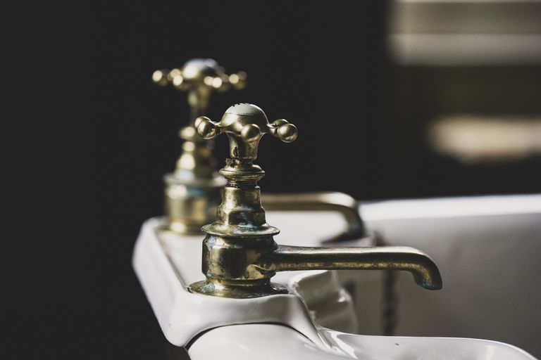 Close up of taps in a bathroom sink.