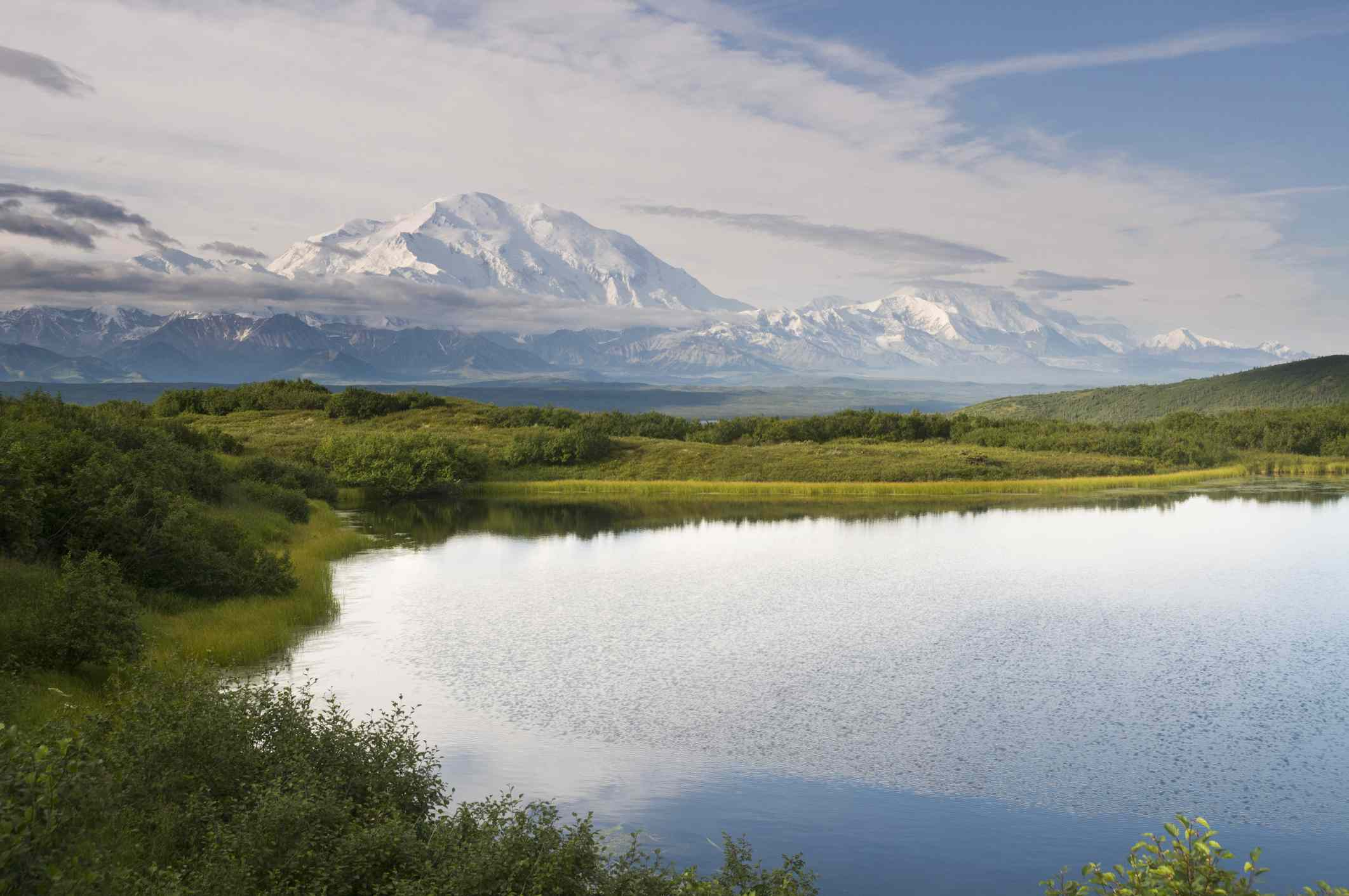 Wonder Lake in Denali National Park with snow covered mountains in the distance