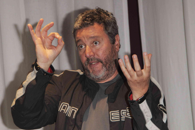 Designer Phillipe Starck speaks using his hands.
