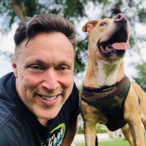 Michael Levitt poses with his dog Toretto.
