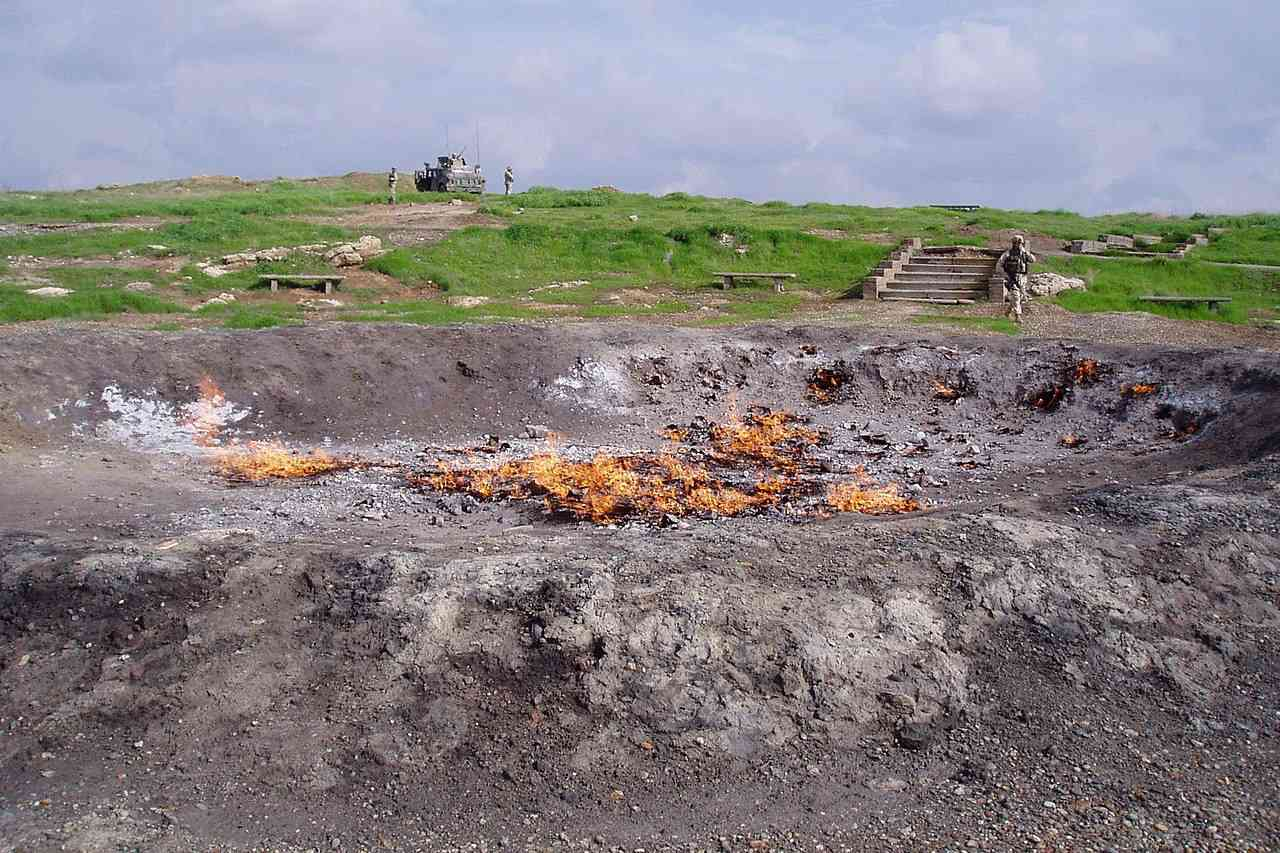 Eternal Fire of Baba Gurgur surrounded by grass