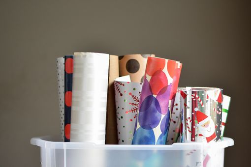bin of wrapping paper rolls