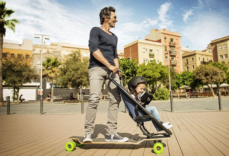 Parent and child on a skateboard stroller