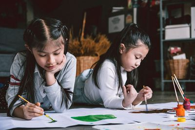 Close up of children painting together