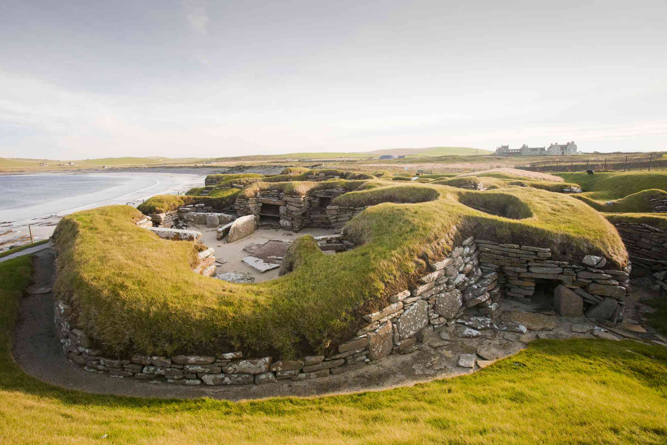 Grass-covered stone settlement on the coast of Scotland