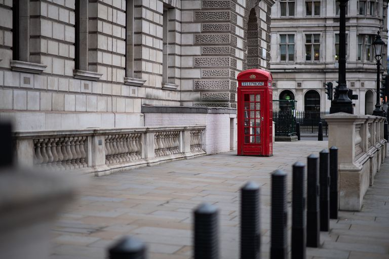 red telephone box in empty Parliament Square, London, which is normally full of tourists