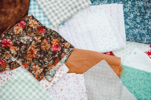 Colorful squares of scrap fabrics.