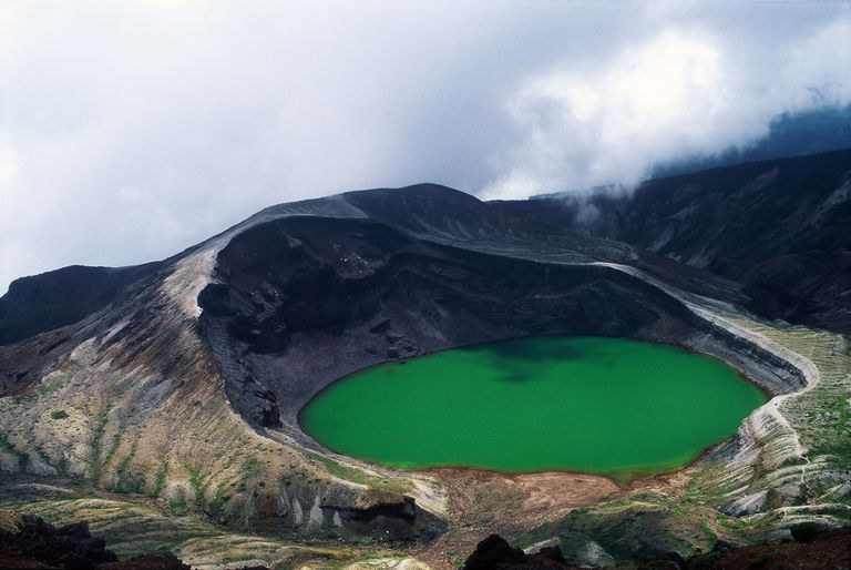 crater like with green water and tall left side