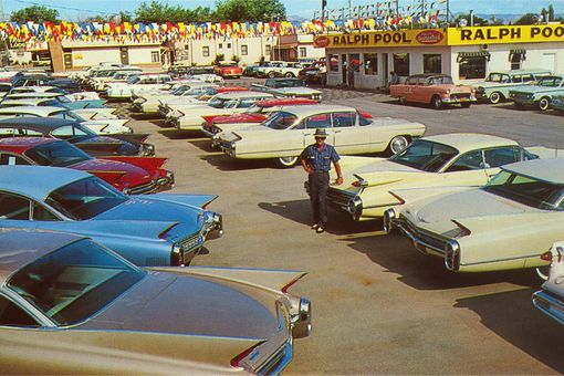 Car lot with Caddilacs