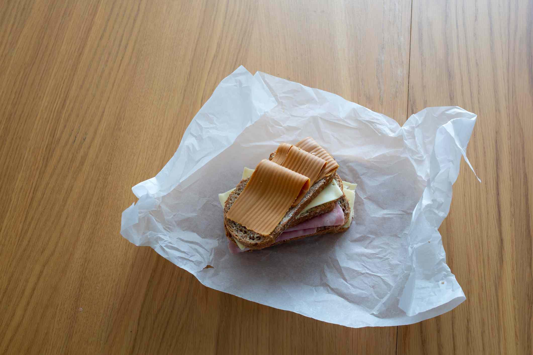 Sandwich in a paper food wrapper.