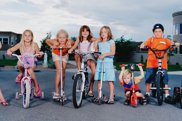 kids on scooters and bikes