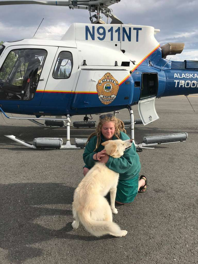 Amelia Milling hugs Nanook after being rescued via helicopter by Alaska State Troopers.