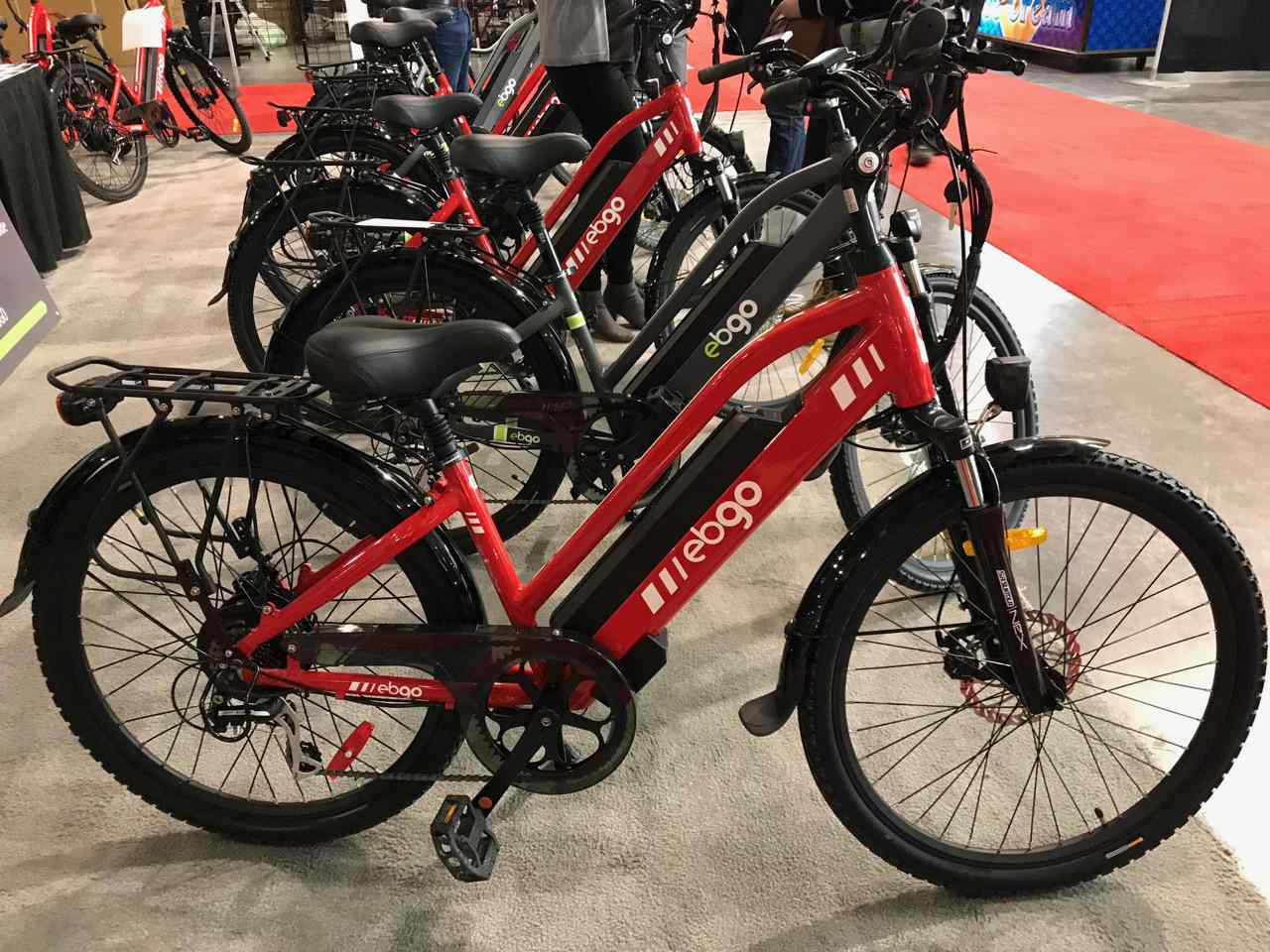 A row of red and black ebikes