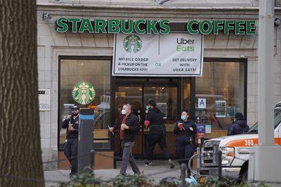 patrons leave Starbucks in NYC during coronavirus