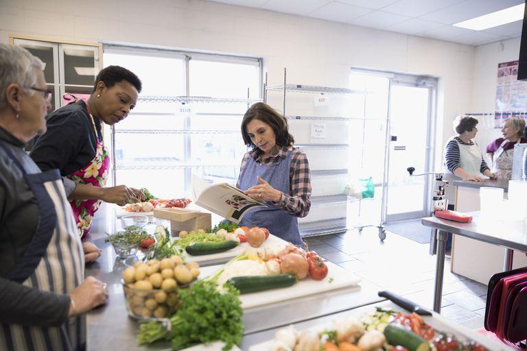 Volunteers cooking in soup kitchen