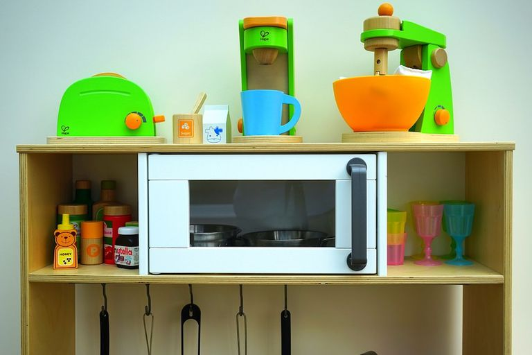 all-wood play kitchen for children with microwave front and center