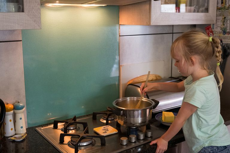 Young girl cooking with gas