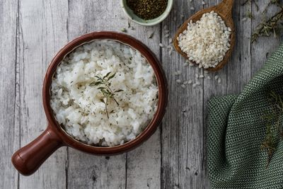shot of cooked rice with ingredients on wood