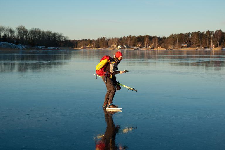 A man skating on natural ice