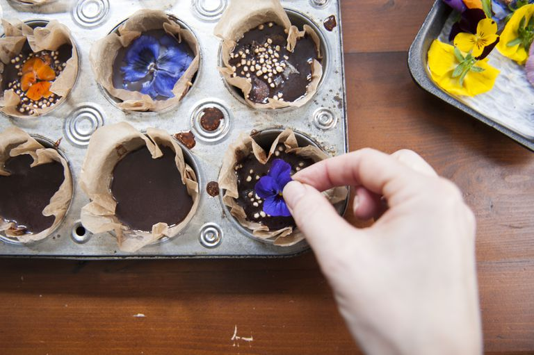 Decorating home made vegan chocolates with edible flowers