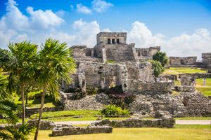 Mayan ruins against blue sky in Tulum, Mexico