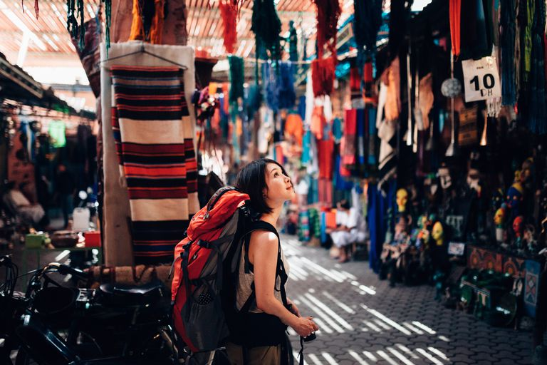 A backpacker walking around a local old market