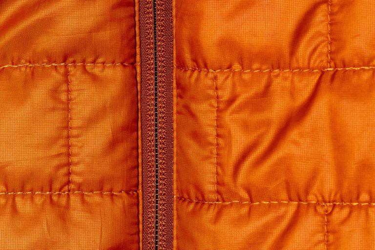 Close up of an orange patagonia puffy jacket