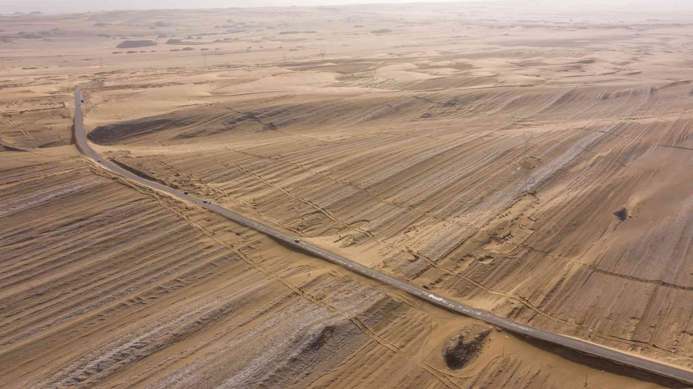 A desert in China with a road running through it.