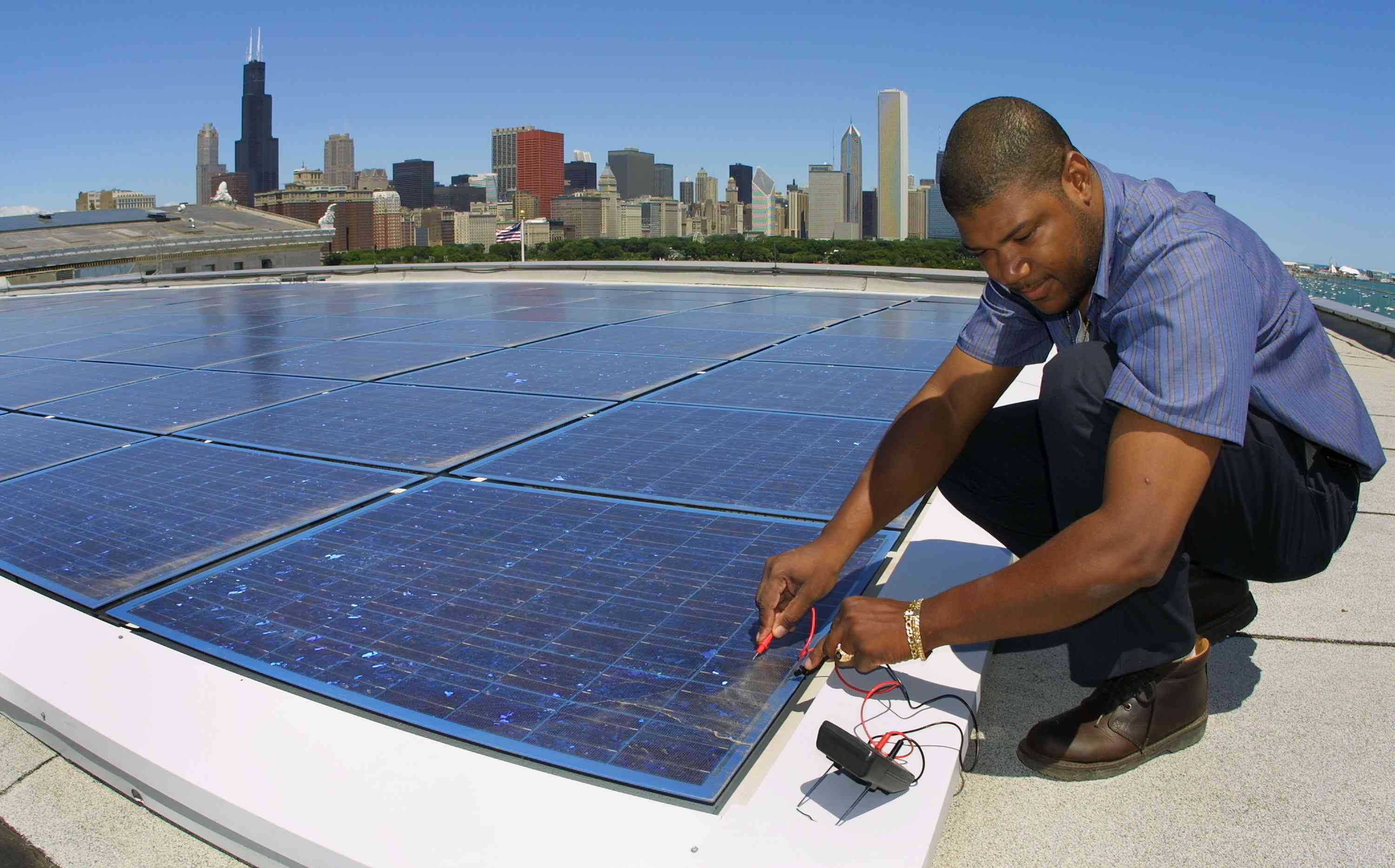Building engineer Ernst Loubeau performs a diagnostic maintenance procedure July 5, 2001 on the solar electric system located on the roof of the Field Museum of Natural History in Chicago.