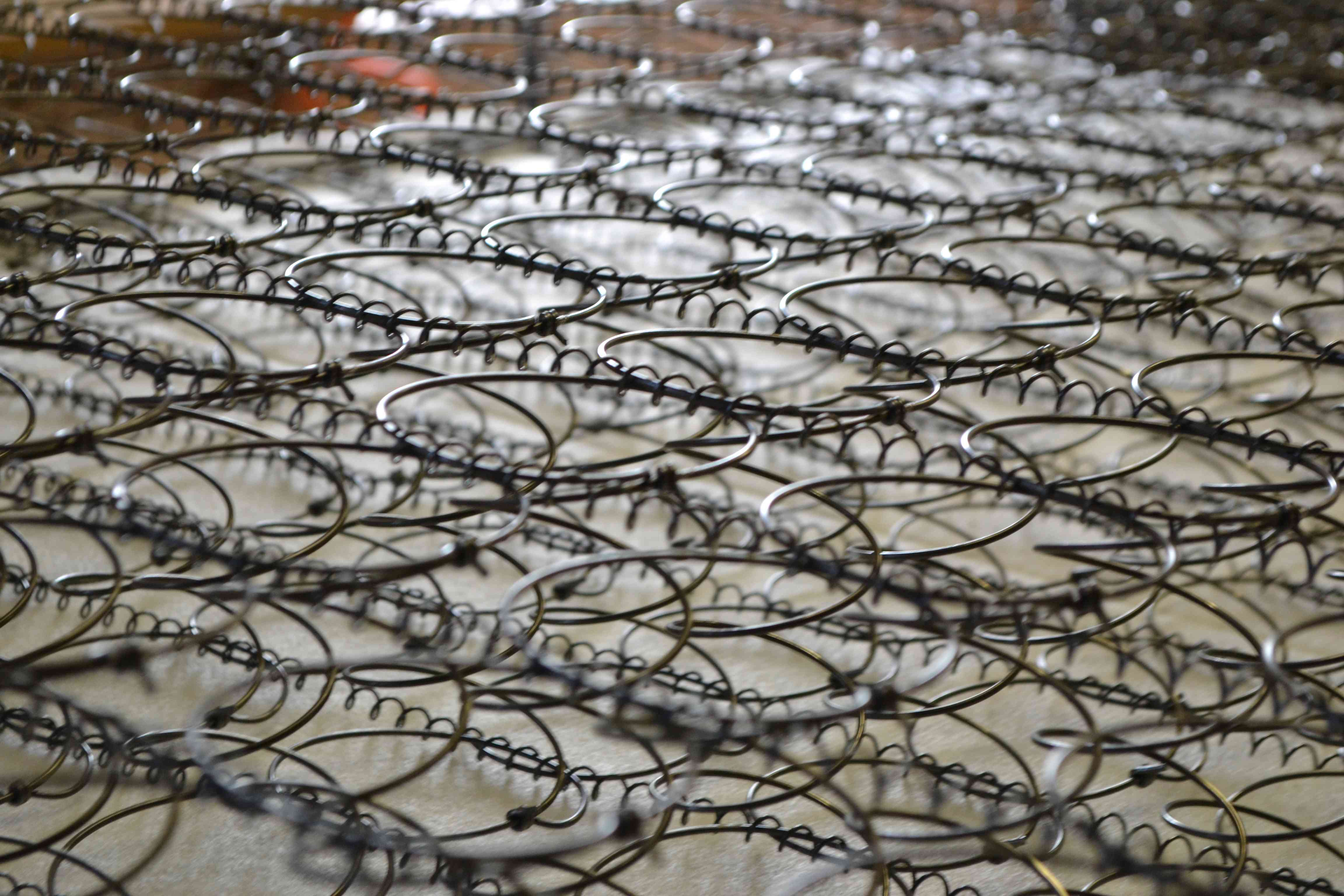 Mattress springs in a factory