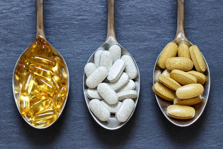 Three spoons with different supplements.