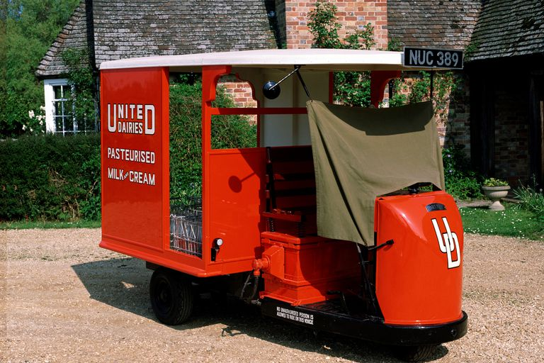 1947 Brush Pony electric milk float parked in front of a house