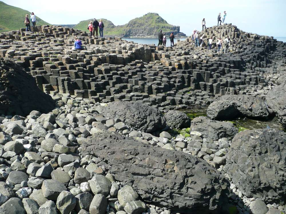 Tourists visit the incredible landscape of Giant's Causeway