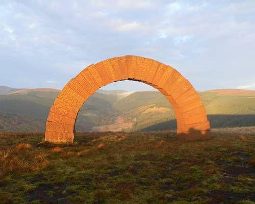 Brick arch against a panoramic vista