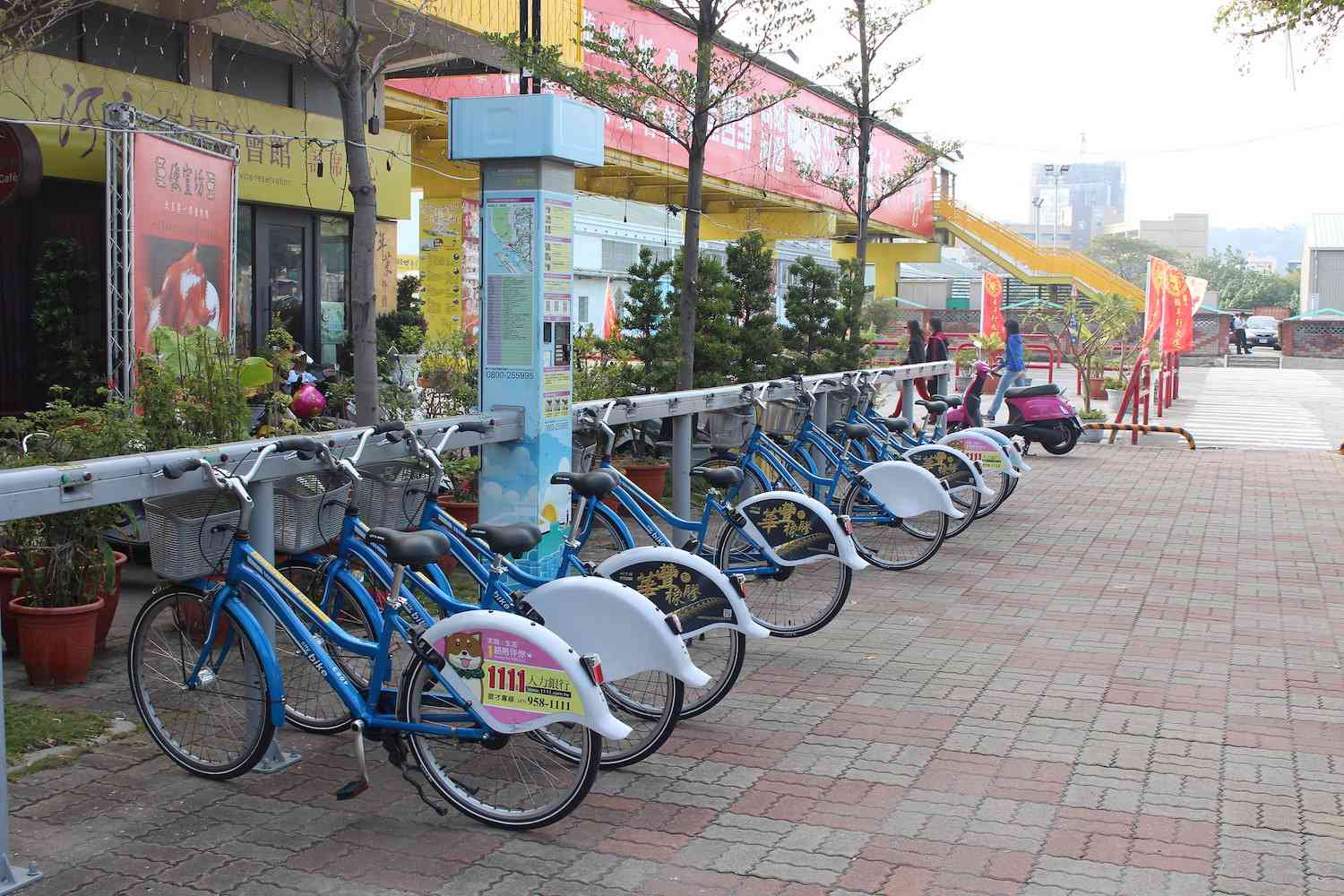 A row of bikes at a kiosk in Kaohsiung, Taiwan