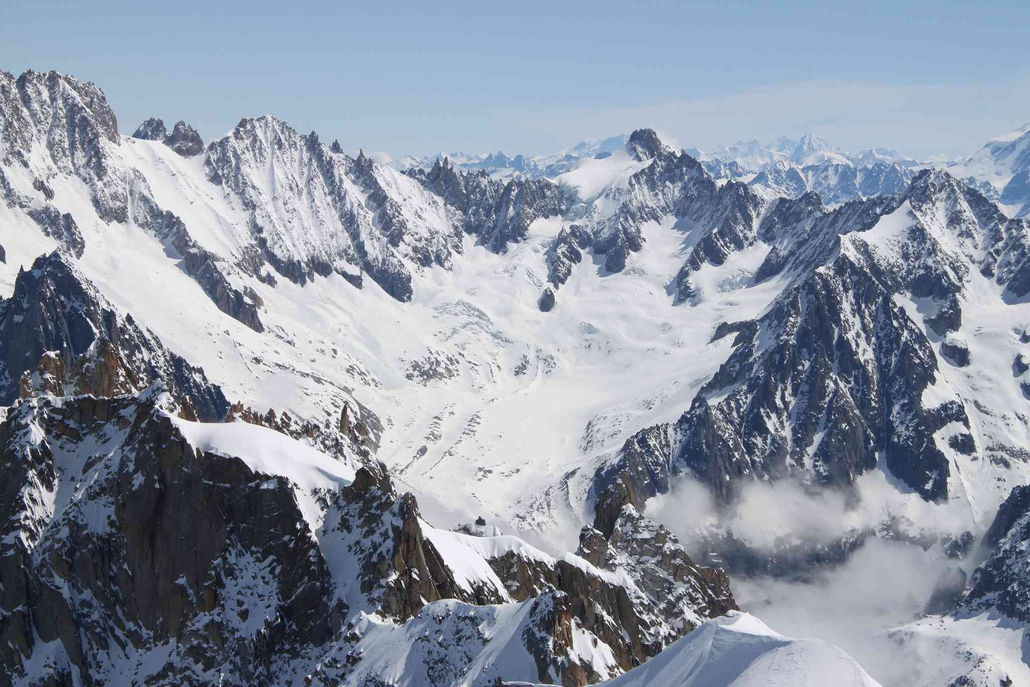 A cirque glacier is formed in a depression on a mountainside, such as Glacier de Talefre.