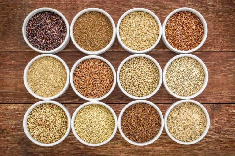 whole grains in bowls against a wooden background