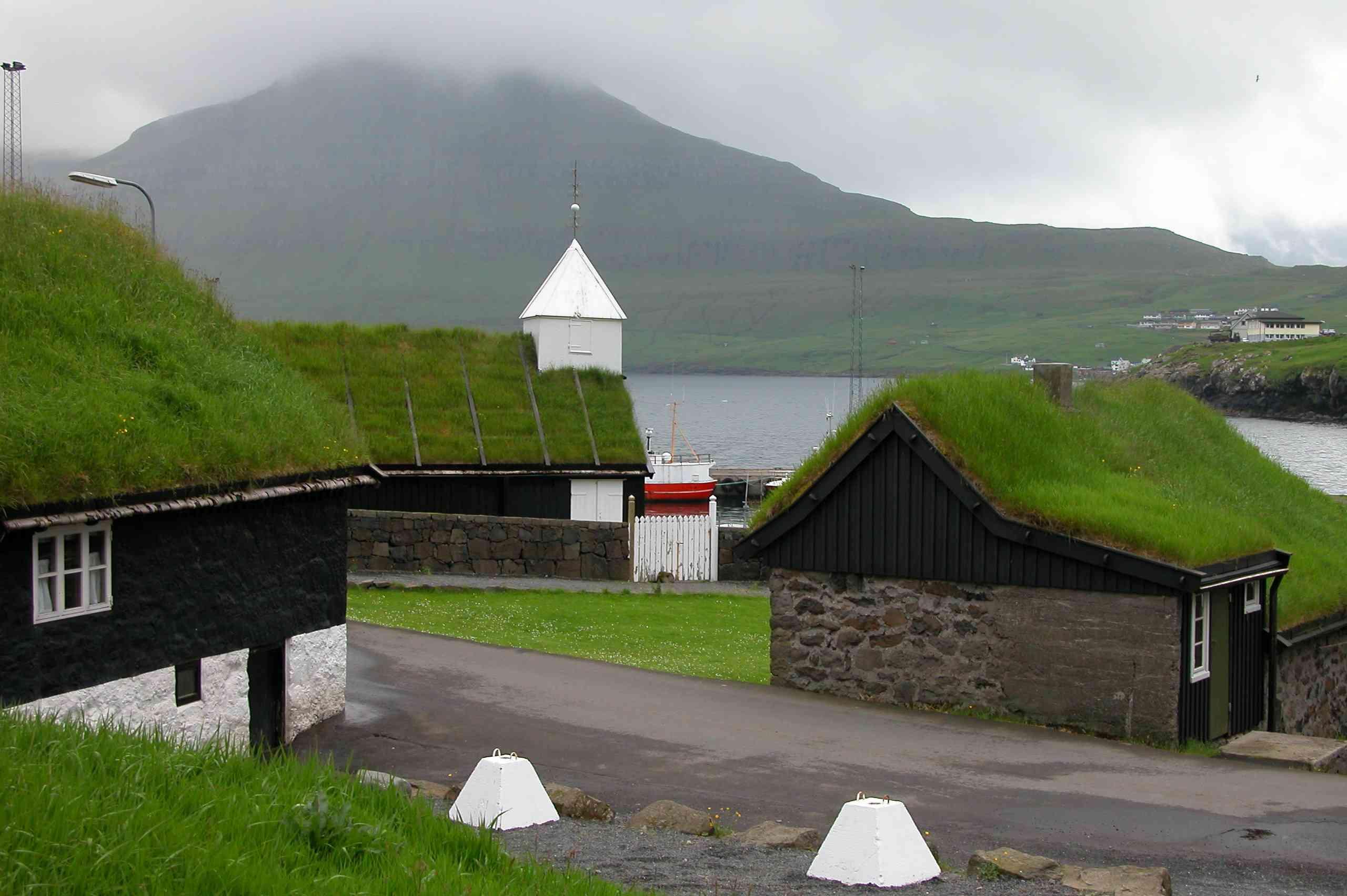 Traditional buildings with green roofs at Norðragøta on Eysturoy, Faroe Islands
