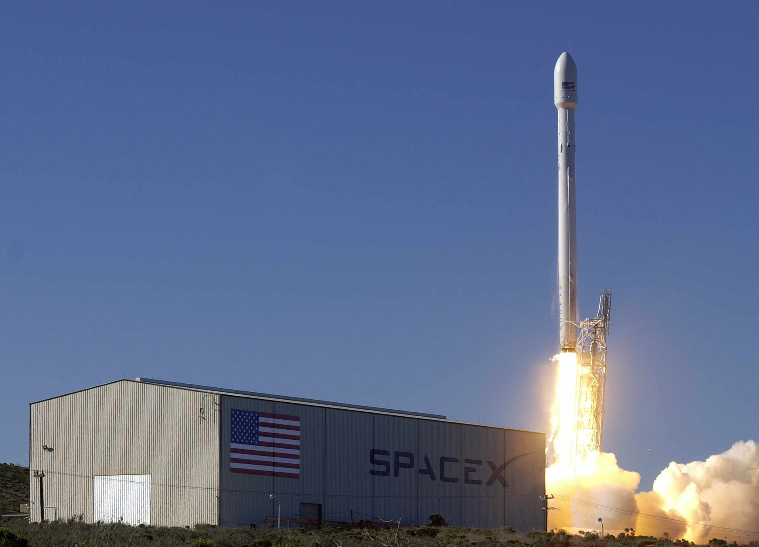 SpaceX Falcon 9 rocket launches with satellite attached