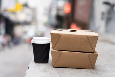Takeaway food and hot coffee.