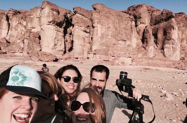 people taking selfie in desert
