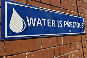 water is precious sign