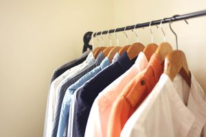 Hanging shirts on open wardrove