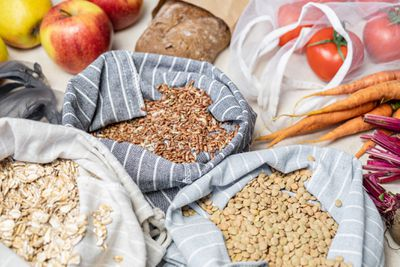 Oatmeal, lentils, and another grain in cotton bags