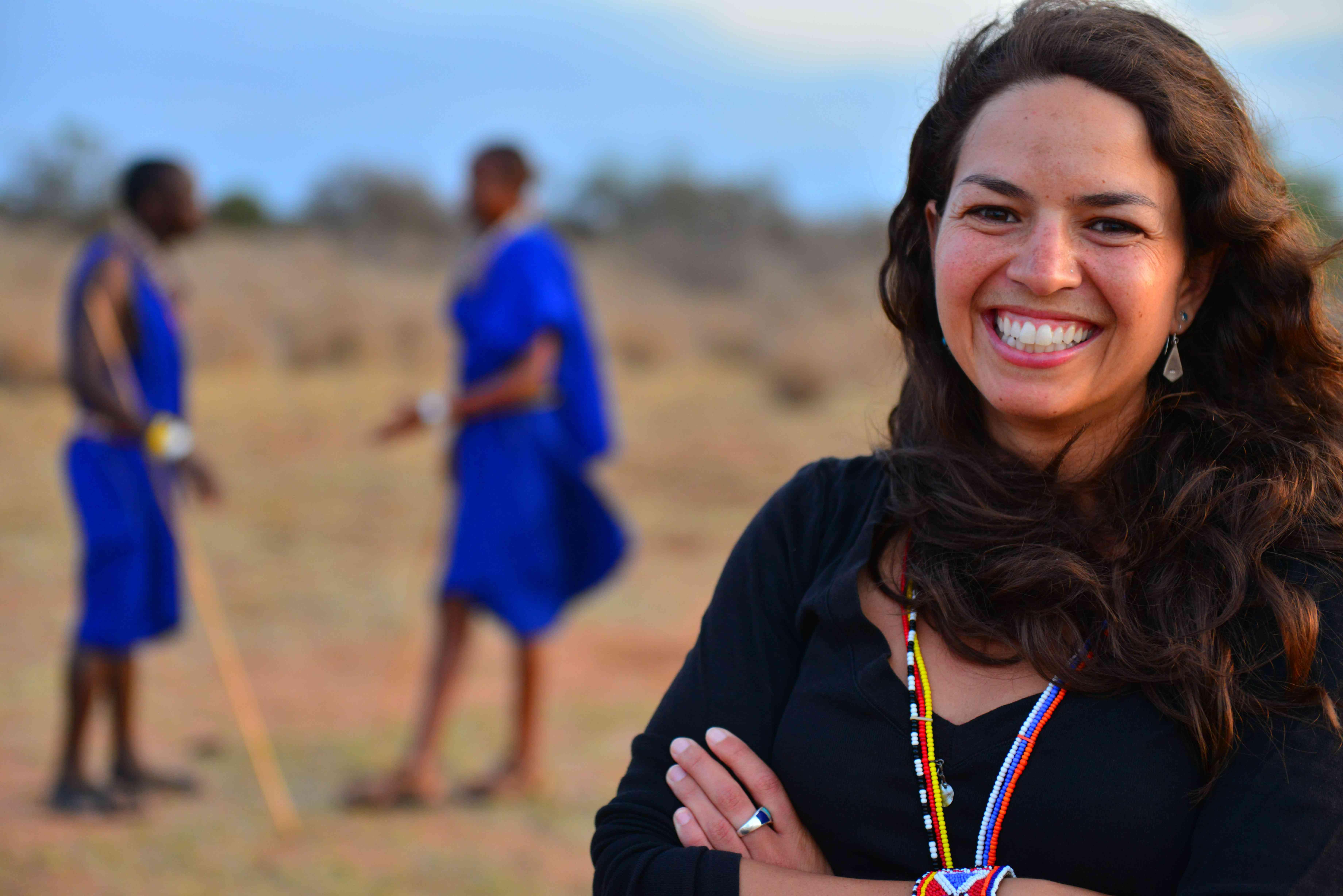 An animal activist standing in front of Maasai warriors.