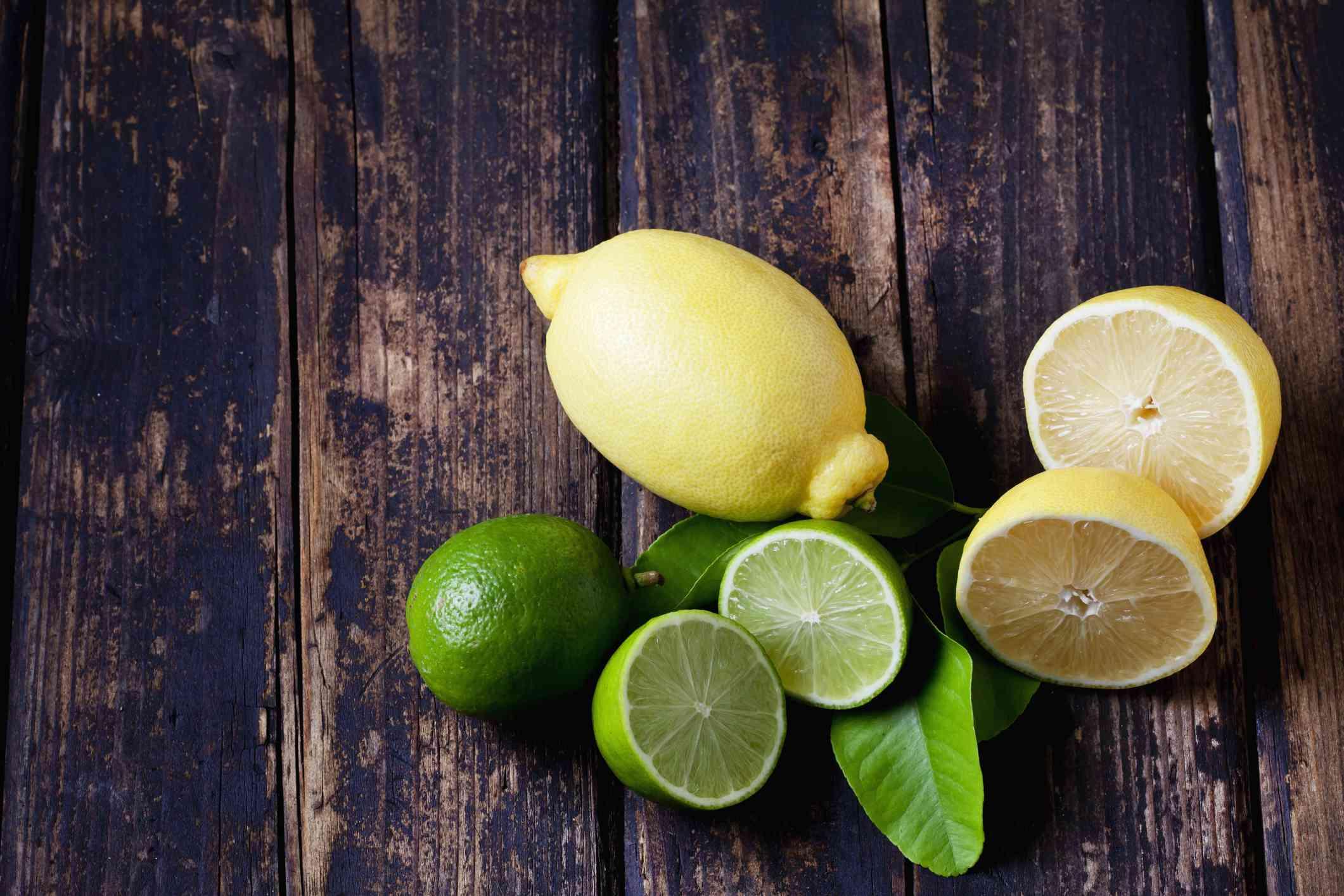 Sliced lemons and limes on a table for blackhead treatment.